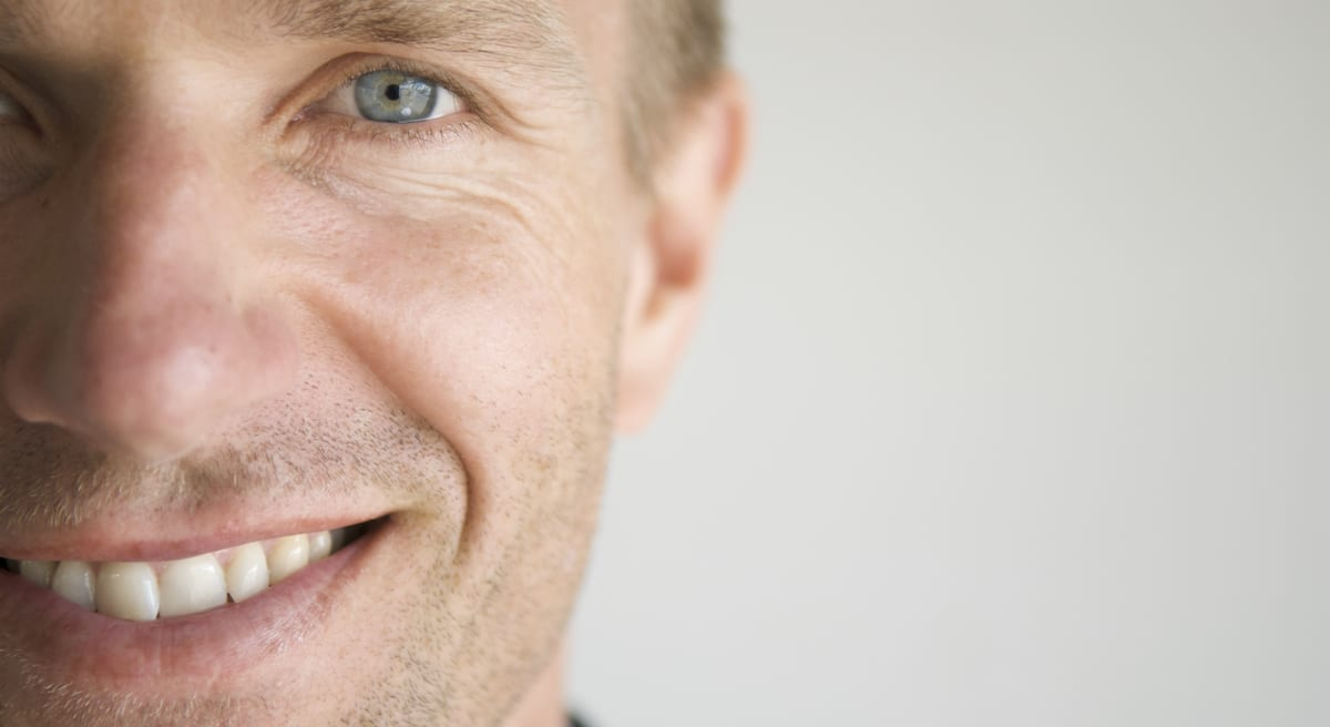 Adult Man Smiling Face Close Up Blue Eyes Horizontal